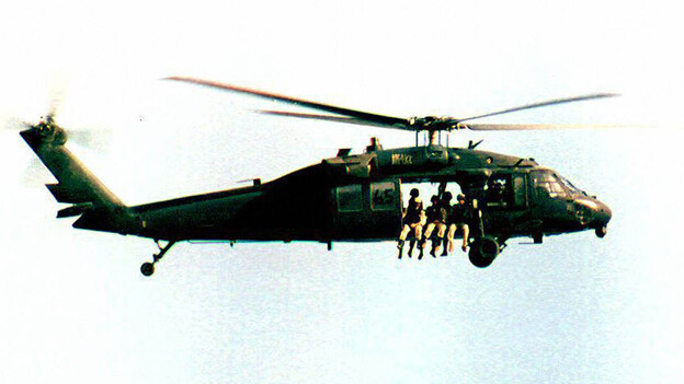 A U.S. UH-60 Black Hawk helicopter flies over Somalia in September 1993, a month before the battle of Mogadishu. (AFP/Getty Images)