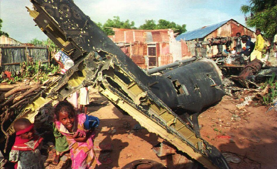 In December 1993, Somali children play around the wreckage of a U.S. helicopter in Mogadishu. (AFP/Getty Images)