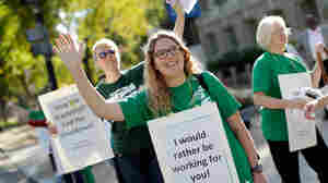 Furloughed federal workers demonstrate in Washington earlier this week. Hundreds of thousands of government employees can't work as long as the House of Representatives and Senate remain gridlocked.
