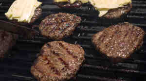Advocates for healthy food in Virginia schools have met a reversal, after cafeterias changed back to hamburgers with additives due to students' complaints. The schools had been serving all-beef burgers such as these, being grilled at a farmer's market.