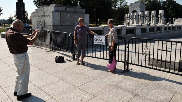 On the sixth day of a federal government shutdown that has barricaded national parks and attractions, tourists take photos at the World World II Memorial in Washington Sunday.