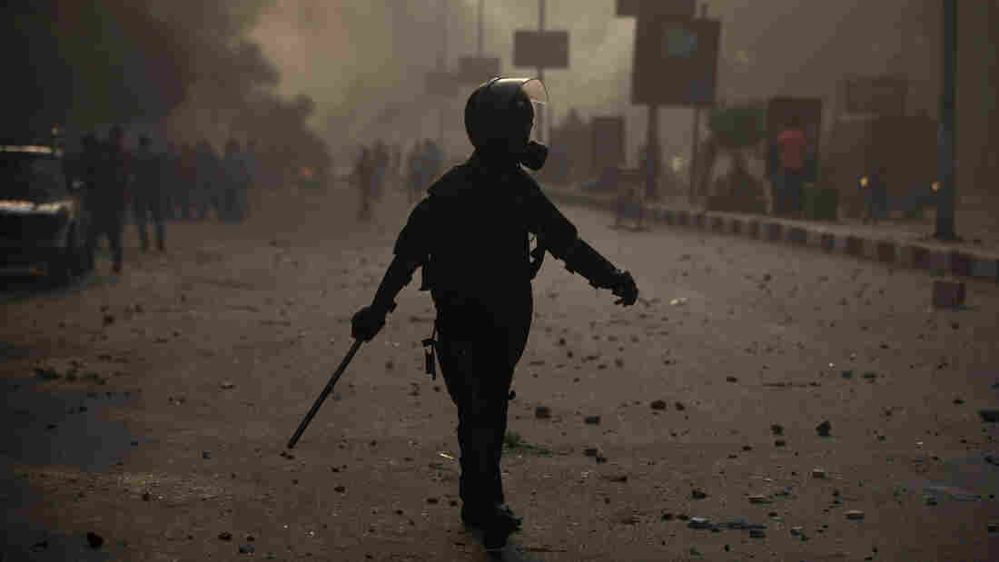 An Egyptian riot policeman moves into position during clashes with supporters of ousted president Mohammed Morsi, in Cairo, Egypt on Sunday.