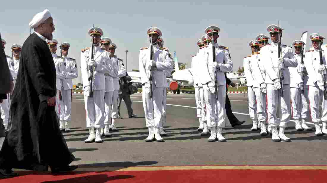 Iranian President Hassan Rouhani reviews the honor guard upon arrival from the U.S. at Mehrabad airport in Tehran, Iran, on Sept. 28. Iranians from across the political spectrum hailed the historic phone conversation between President Barack Obama and Rouhani, reflecting wide support for an new tone between the two nations.