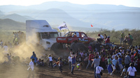 People in a crowd flee as an out-of-control monster truck plows through spectators at a Mexican air show in the city of Chihuahua Saturday. Officials say they are investigating the incident, in which eight people died.