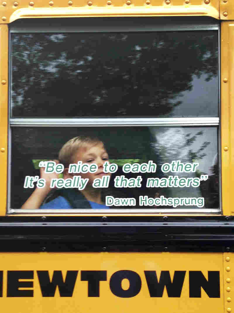 Voters in Newtown, Conn., have approved a plan to use nearly $50 million in state funds to demolish Sandy Hook Elementary and build a new school in its place. This photo provided by Craig Hoekenga shows his son Trey, a kindergarten student at Sandy Hook, on the school bus this year. The window has a quote from the late principal, Dawn Hochsprung, who was killed in last December's mass shooting.