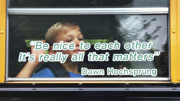 Voters in Newtown, Conn., have approved a plan to use nearly $50 million in state funds to demolish Sandy Hook Elementary and build a new school in its place. This photo provided by Craig Hoekenga shows his son Trey, a kindergarten student at Sandy Hook, on the school bus this year. The window has a quote from the late principal, Dawn Hochsprung, who was killed in last December's mass shooting. (AP)
