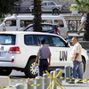 United Nations vehicles leave a Damascus hotel last week. The team of international disarmament experts began to dismantle Syria's chemical weapons production facilities on Sunday.