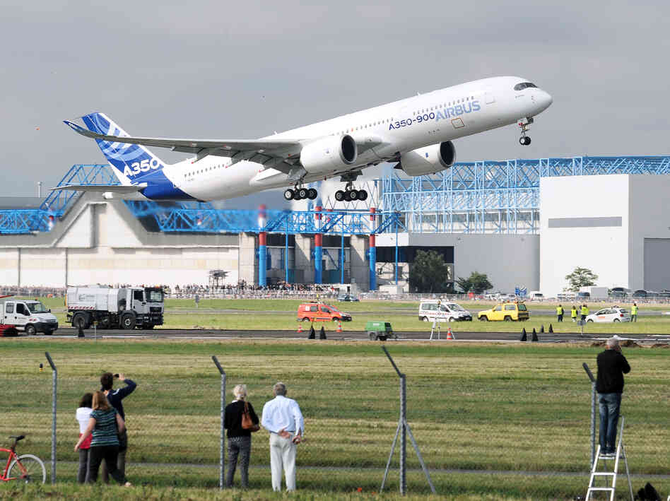 An Airbus A350-900 takes off from an airport in Toulouse, France, on