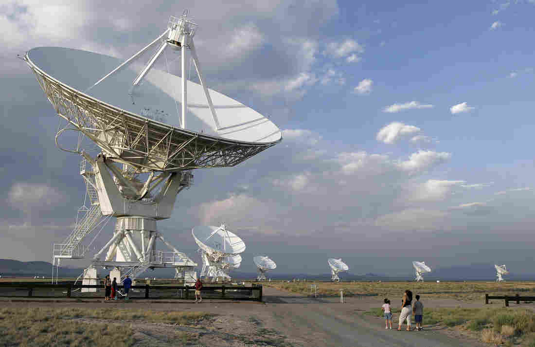 Tourists are dwarfed by the Very Large Array in 2005. The facility, on the Plains of San Agustin, 50 miles west of Socorro, N.M., has been closed as a result of the government shutdown. The VLA consists of 27 radio antennas linked together to simulate the capabilities of a single dish 17 miles in diameter.