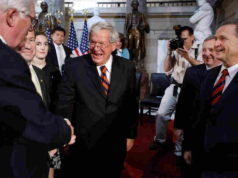 Former House Speaker Dennis Hastert of Illinois is congratulated by members of Congress during the unveiling of his portrait at the Capitol in 2009.