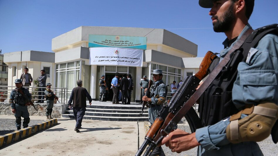 Afghan police secure the office of the Independent Election Commission in Kabul on Sunday, the last day candidates could register to stand in the country's upcoming presidential election.