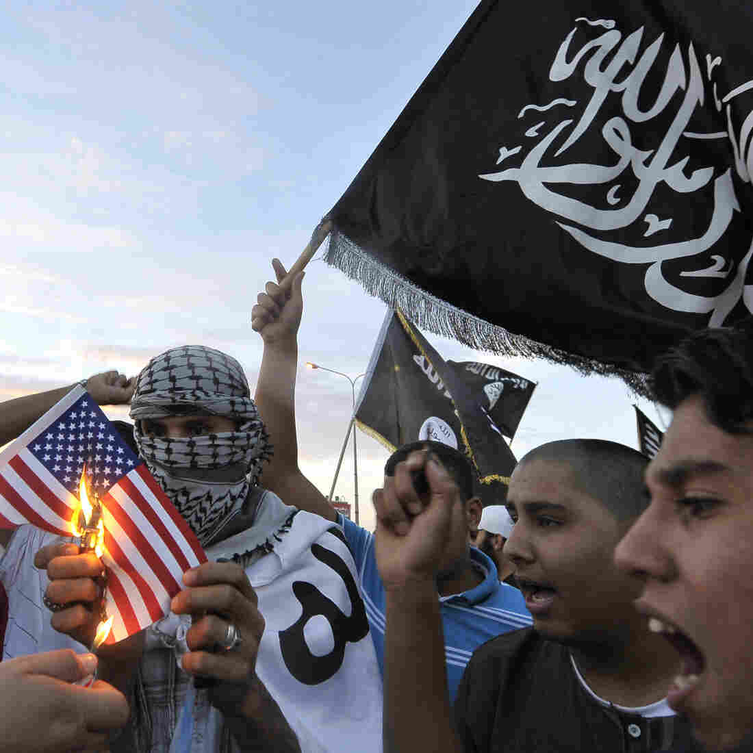 Libyan protesters burn a replica of the U.S. flag on Monday during a demonstration against the capture of Abu Anas al-Libi. U.S. forces seized him Saturday in the Libyan capital Tripoli. He is accused of involvement in two U.S. embassy bombings in Africa in 1998 and is being held on a U.S. Navy ship in the Mediterranean Sea.