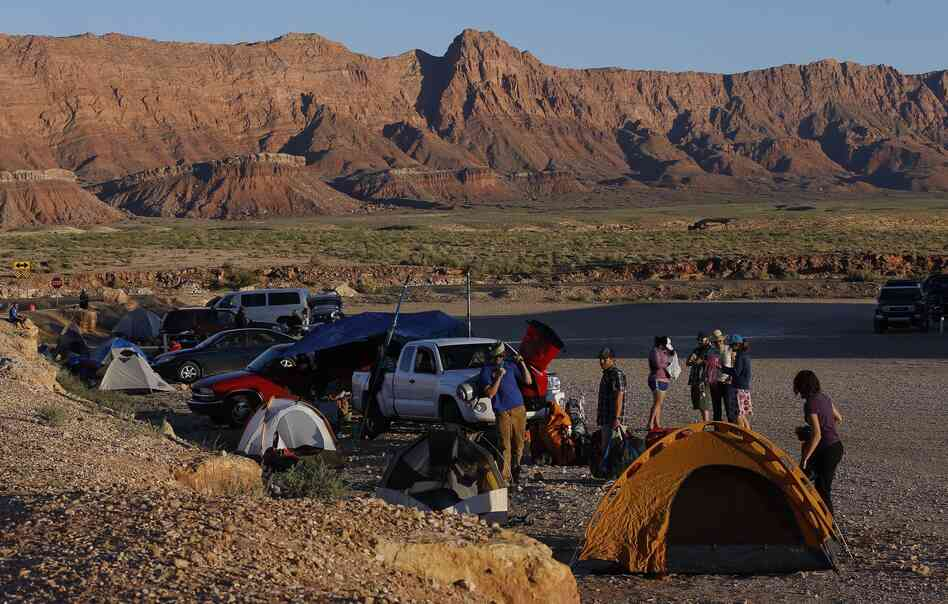 People who for years had planned to be boating down the Colorado River in the Grand Canyon right about now instead found themselves on Saturday camping in a parking lot because of the government shutdown.
