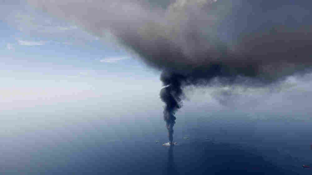 The Deepwater Horizon oil rig is seen burning in the Gulf of Mexico in April 2010. A second phase of the BP trial, which started this week, looks at just how much oil spilled into the Gulf.