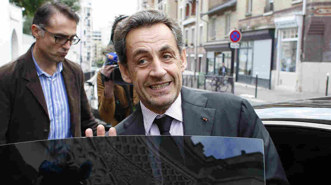 The decision to dismiss charges against former French President Nicolas Sarkozy, seen here in Paris Monday, could clear the way for him to return to politics.
