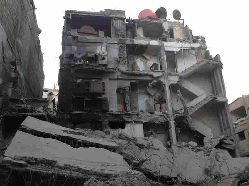 A bombed-out building in Zamalka, a neighborhood in east Ghouta, Syria. The destruction seen in this picture was caused mostly by government air raids months before the Aug. 21 chemical attack on the neighborhood.