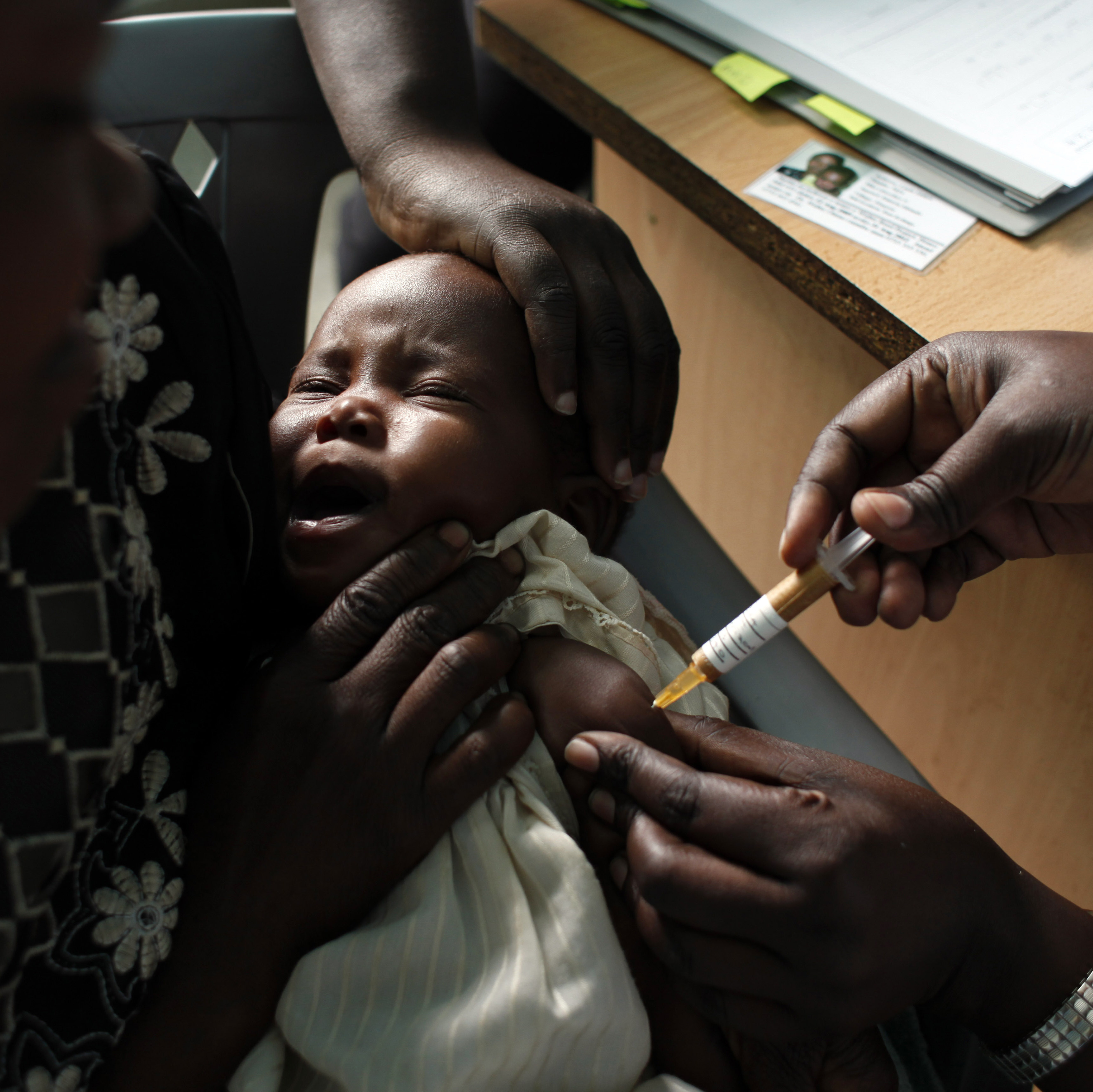 A baby receives a malaria vaccine during a clinical trial at the Walter Reed Project Research Center in Kombewa, Kenya.