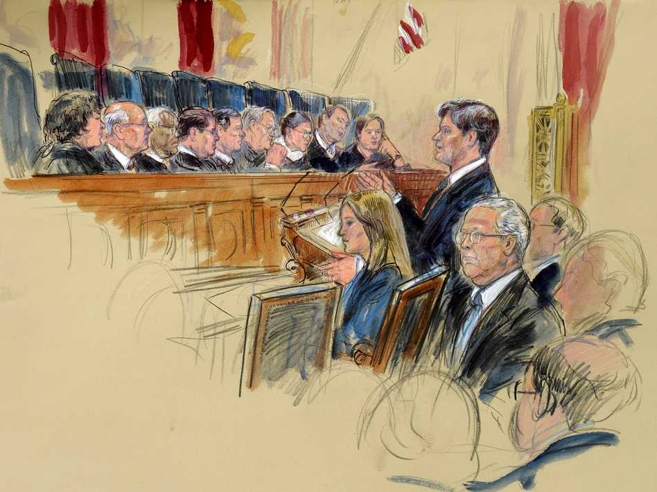 This artist rendering shows Senate Minority Leader Mitch McConnell, R-Ky., seated (center) as attorney Bobby Burchfield argues during the Supreme Court's hearing on campaign finance Tuesday.