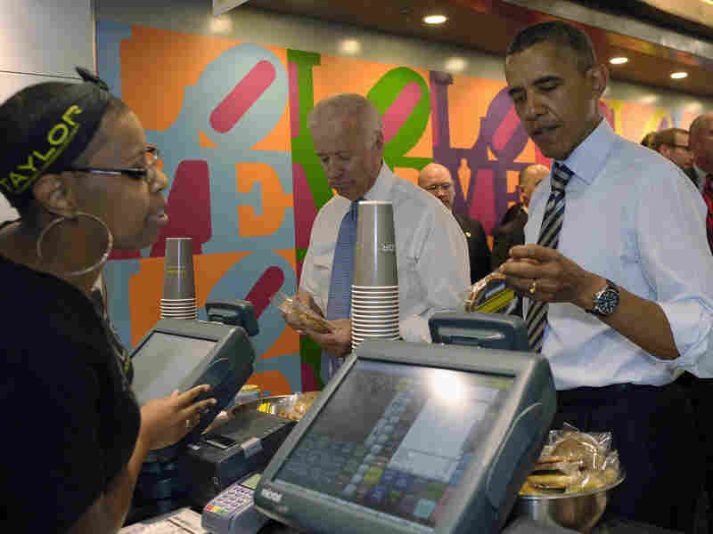 President Obama and Vice President Biden order lunch at Taylor Gourmet sandwich shop near the White House on Friday. Other D.C eateries and bars are offering shutdown specials to attract customers.
