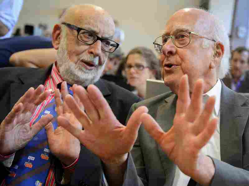 Peter Higgs (right) speaks with Belgian physicist Francois Englert, who were jointly awarded the 2013 Nobel Prize in physics, at a news conference last year.
