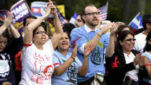 Protesters chant during the immigration reform rally in front of the U.S. Capitol on Tuesday. Capitol Police arrested 200 demonstrators after they sat down and blocked a street.