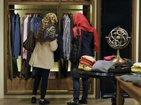Two Iranian women look at clothing in a store in Tehran. Iranians have launched a