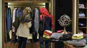 """Two Iranian women look at clothing in a store in Tehran. Iranians have launched a """"jeans protest"""" on the Web in response to a comment by Israel's leader Benjamin Netanyahu."""