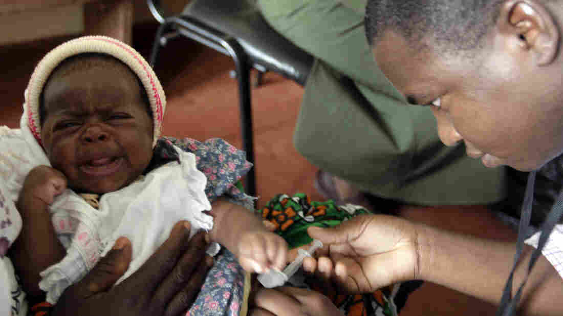 A health worker administers the malaria vaccine at a clinical trial in Kilifi, Kenya.