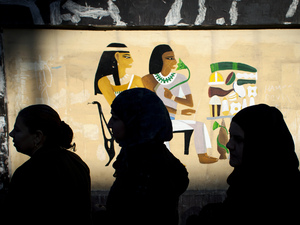 Egyptian women queue outside a polling station during voting on a disputed constitution drafted by Islamist supporters of then-President Mohammed Morsi, in Giza, Egypt, last December. In a country divided by a political crisis, families are not spared.
