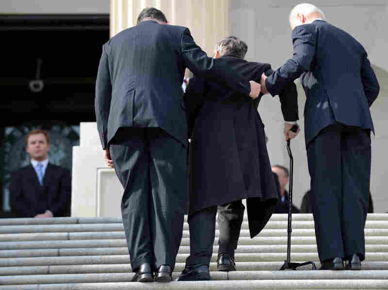 Sen. Mark Kirk, R-Ill., gets help entering the Capitol from Vice President Joe Biden (right) in January 2013, one year after suffering a stroke at age 52.