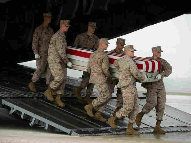 The remains of a U.S. soldier killed in Afghanistan in May arrive at Dover Air Force Base in Delaware. In Breach of Trust, writer and veteran Andrew Bacevich asks whether we the people are sufficiently connected to those who fight our wars — and die in them.