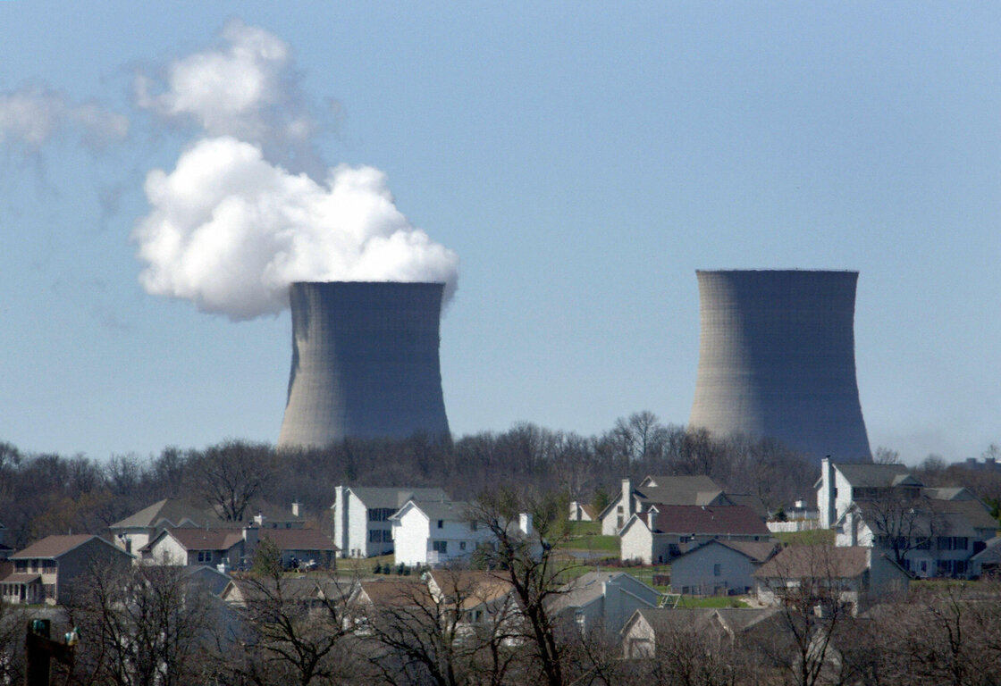 Homes sit next to the Exelon Bryon Nuclear Generating Stations in Bryon, Ill.