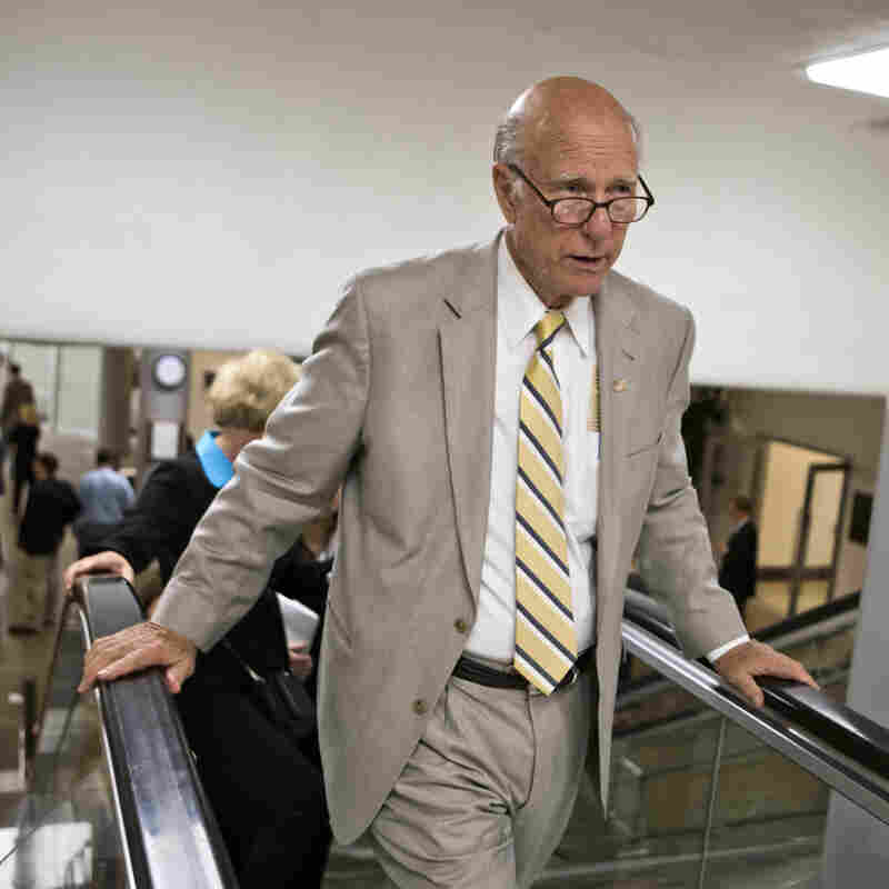 Sen. Pat Roberts, R-Kan., and other senators rush to the floor for a vote in July. Roberts faces a 2014 primary challenge from a distant relative of President Obama's.