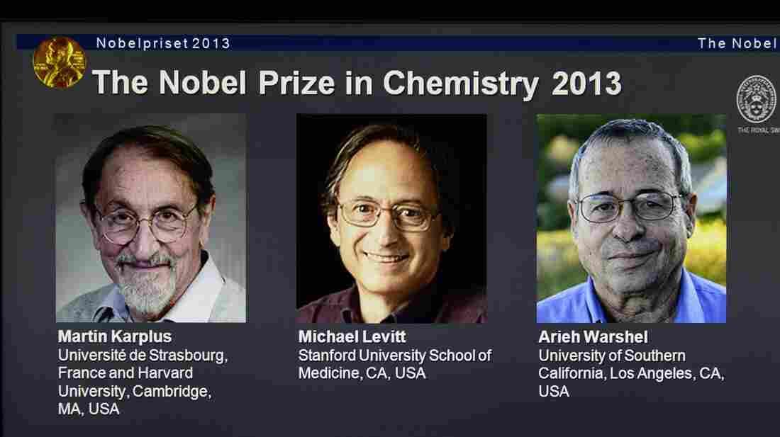 A screenshot of the Nobel Prizes webpage showing the 2013 chemistry laureates Martin Karplus, Michael Levitt and Arieh Warshel.