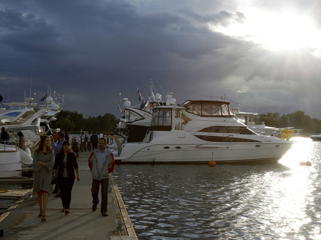 Prospective clients walk past yachts during the Millionaire Boat Show at the Royal Yacht Club in Moscow on Sept. 3, 2011. A new report says Russia has the highest rate of inequality in the world – barring some small Caribbean islands.