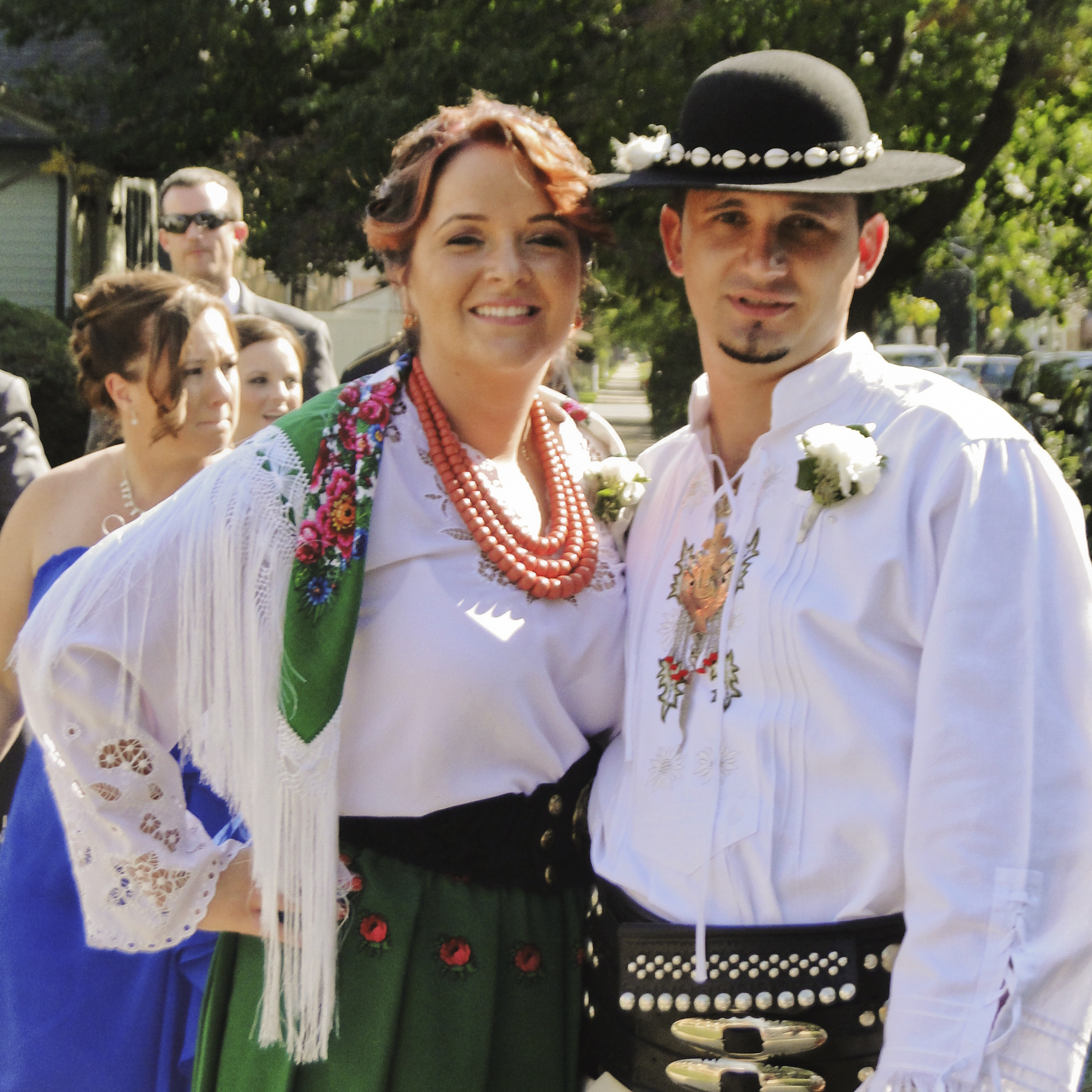 Guests pose in traditional Polish Highlander garb before heading to the church ceremony.