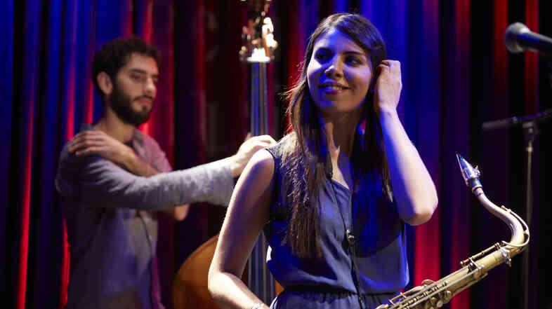 Melissa Aldana performs with her Crash Trio, including bassist Pablo Menares.