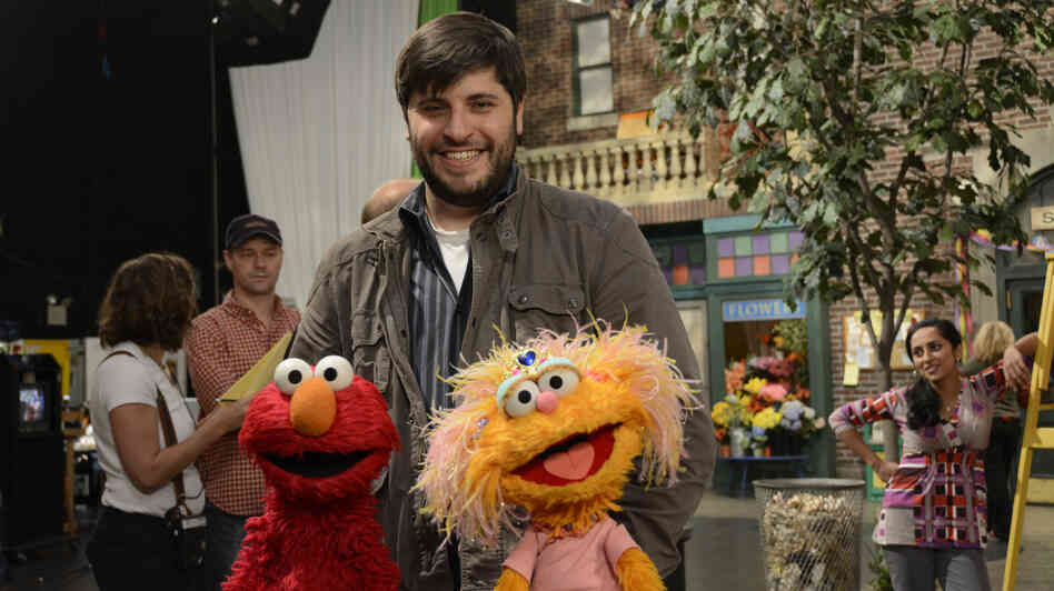Sesame Street music director Bill Sherman with Elmo and Zoe on the set. Sherman won a Tony Award for In the Heights in 2008 and has recruited Broadway peers to compose for the children's show.