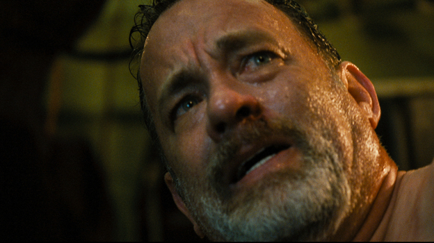 In the emotionally fraught thriller Captain Phillips, Tom Hanks plays the real-life freighter captain whose Maersk Alabama was overtaken by Somali pirates in 2009. (Columbia Pictures)