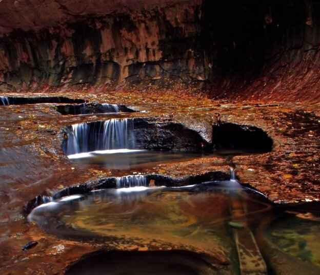 "An autumn scene in the canyon known as ""The Subway"" in Zion National Park in Utah, which is now off-li"