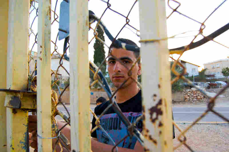 Almost a decade ago, an Israeli filmmaker made a short documentary about Palestinian Ishaq Amer and his family after a part of Israel's separation barrier was built around their home in the West Bank. Ishaq was cut off from his soccer buddies then. Now, at 19, he's a husband and a father.