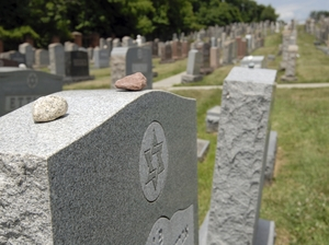 Stones placed on a Jewish grave to show respect for the deceased. Orthodox Rabbi Joseph Telushkin says Jewish tradition holds that there is an afterlife but doesn't encourage speculation on what it might be like.