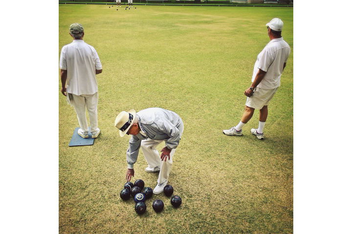 Pasadena, Calif. KPCC photographer Maya Sugarman passes the Pasadena Lawn Bowling Club every morning on her way to work. She drives 35 miles, parks at the nearby train stop and walks to the radio station. The bright green lawn and white outfits always catch her eye.
