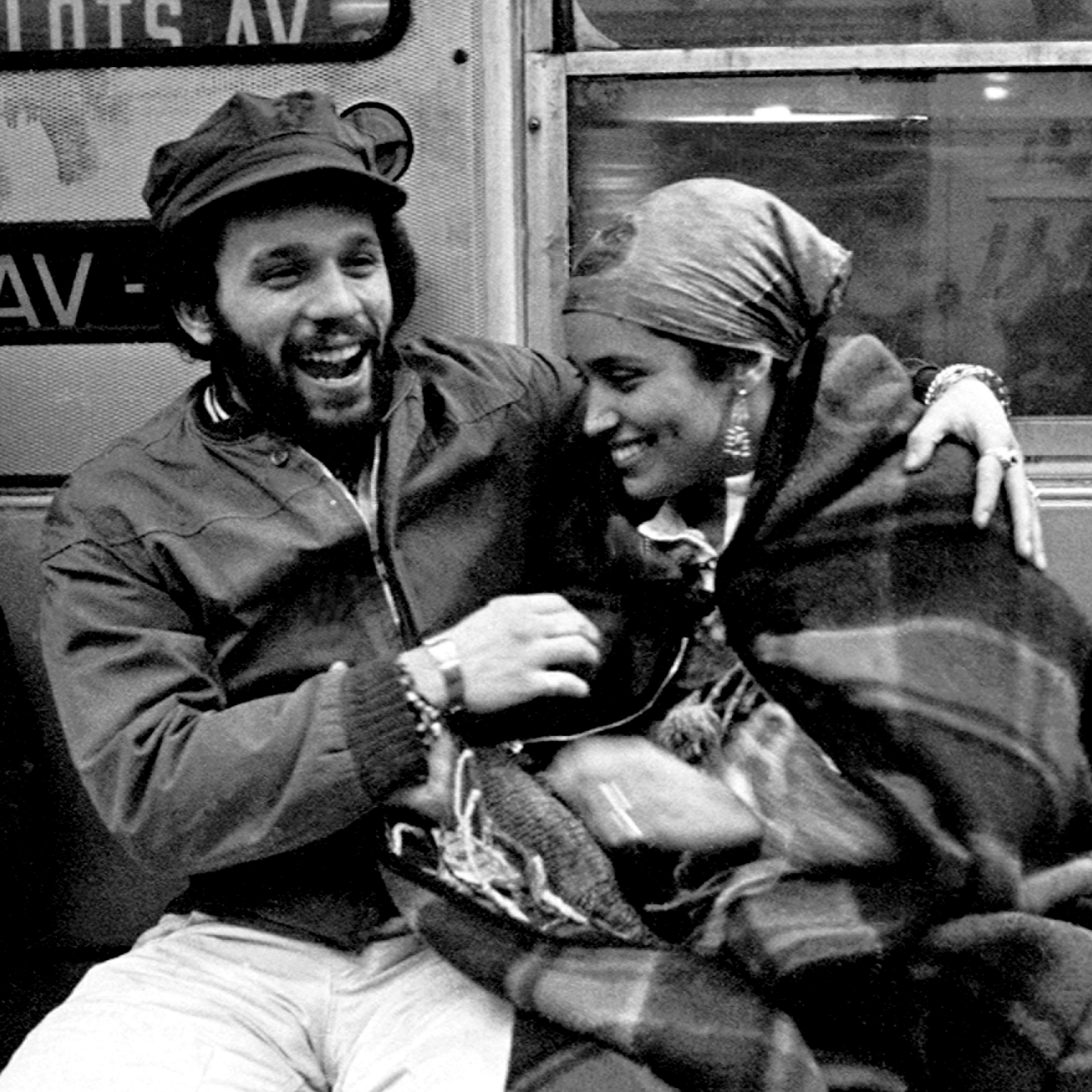 Miguel Piñero of the Nuyorican literary movement and poet Sandra Maria Esteves on the train in New York City in 1977.