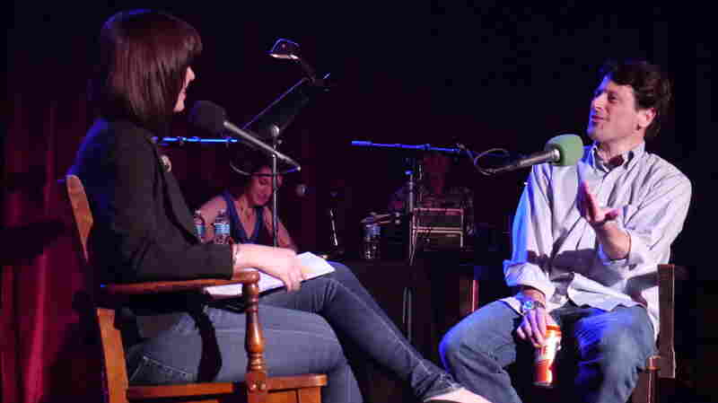 Very Important Puzzler Tom Ruprecht waxes poetic on writing phony oral histories with Ask Me Another host Ophira Eisenberg on stage at The Bell House in Brooklyn, NY.