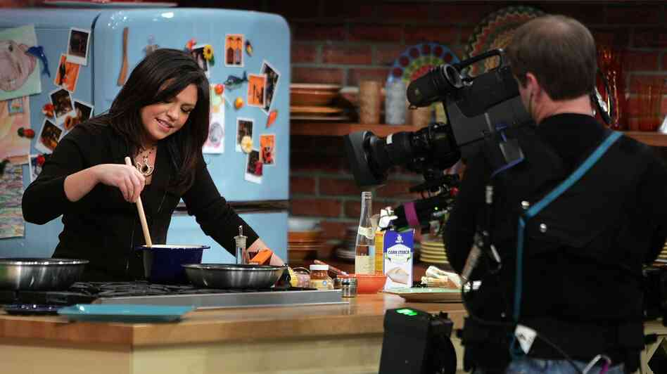 "According to journalist Allen Salkin, Emeril Lagasse initially opposed bringing Rachael Ray, pictured here in 2007, onto the Food Network – and, at first, Ray agreed with him. ""You have this all wrong,"" she told executives, ""I'm beer in a bottle; you guys are champagne."""