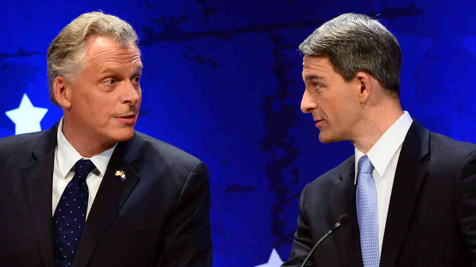 Democrat Terry McAuliffe (left) and Republican Ken Cuccinelli talk before a debate in the Virginia gubernatorial race, last month in McLean, Va.