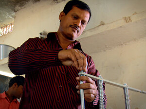 Arunachalam Muruganantham installs his machine in a village in Chhattisgarh, India.