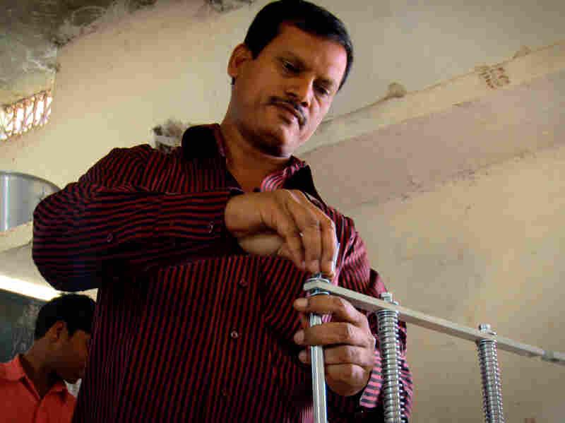 Arunachalam Muruganantham installs his machine in a village in Chhattisgarh, India.