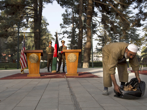 Ahead of an expected — and repeatedly delayed — news conference, an Afghan worker leaves the area where Secretary of State John Kerry and Afghan President Hamid Karzai were expected to speak Saturday in Kabul.